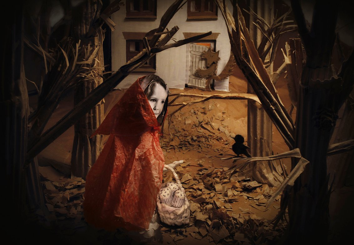 Red Riding Hood and the Wolf. A photographed installation made from paper and card